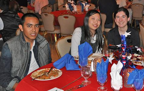 Jose Esparza sits with others from HHS at the EF Smithsonian Student Ball.