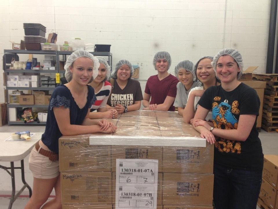 Members of last year's American Studies class show off their hairnets at Feed My Starving Children.