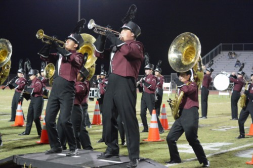 Nathan Bozicevic (12) and Luis Palacio (11) jam out during the marching band halftime show.