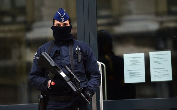 An armed and protected officer outside of Belgium's federal prosecutors office in Brussels.