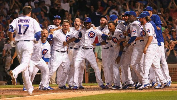 CHICAGO%2C+IL+-+JULY+27%3A+Members+of+the+Chicago+Cubs+wait+to+welcome+Kris+Bryant+%2317+after+he+hit+a+game-winning%2C+two-run+home+run+in+the+bottom+of+the+9th+inning+against+the+Colorado+Rockies+at+Wrigley+Field+on+July+27%2C+2015+in+Chicago%2C+Illinois.+The+Cubs+defeated+the+Rockies+9-8.+%28Photo+by+Jonathan+Daniel%2FGetty+Images%29