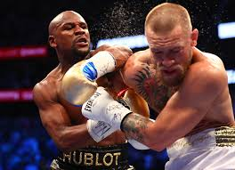 Mayweather Wins By TKO