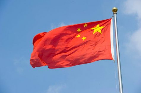 SHANGHAI, CHINA - August 5: The Chinese flag flaps in the wind on August 5, 2010 in Shanghai, China. (Photo by Lucas Schifres/Getty Images)